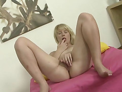 A youthfull ash-blonde woman is laying on her back on the bed. She has her gams opened up enrapture and is finger nailing her pussy. She gets up and heads down on her knees with her ball-sac towards the camera and proceeds to masturbate.