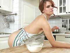 European bombshell gets muddy in the kitchen and caresses her photos on the counter