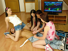 4 CFNM teenagers pounding a nude stud right on the floor
