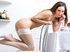 Angelic stunner Sabrine caresses all over her figure leisurely undressing nude to her stockings. She embarks to rubdown her adorably shaven pinkish snatch while toying with her hard knockers until she reaches orgasm.
