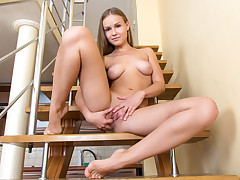 European bombshell plays with her knockers and finger screws her photos on the stairs
