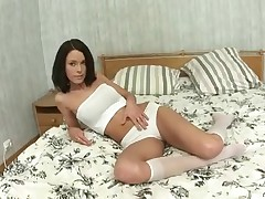Passionate Nubile spinner entices her cunt with her frigs