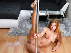 Beautiful redhead Chrissy Fox plays on a pillar before finger screwing her humid vagina to ejaculation